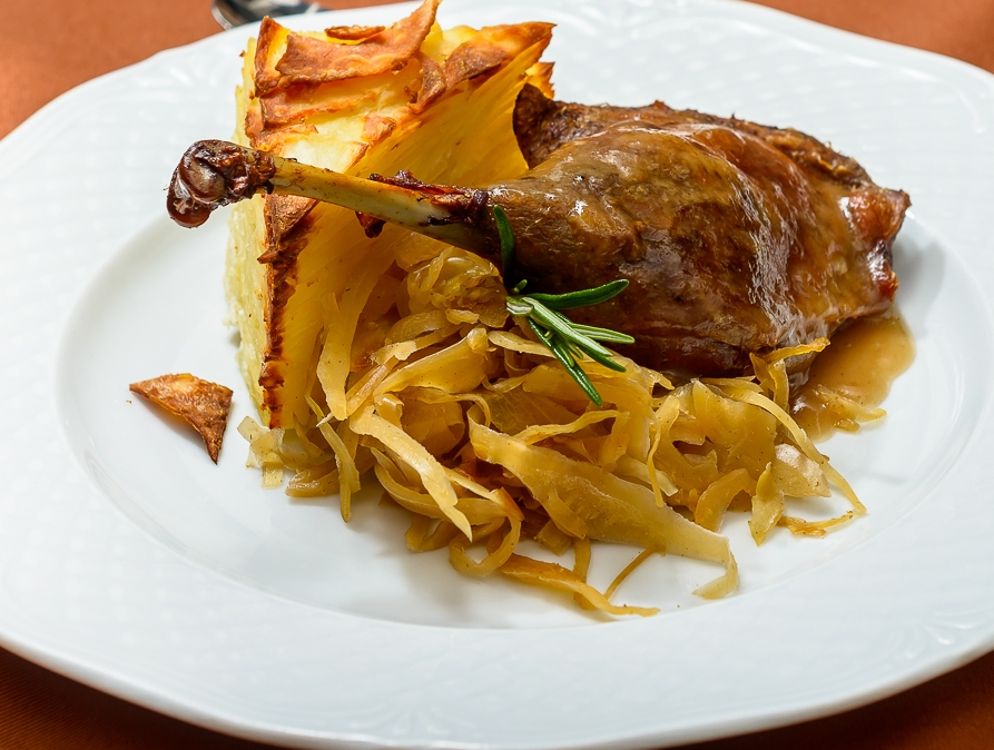 Duck leg confit with crispy white cbbage and gratin potatoes