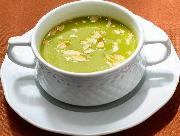 Green pea cream soup with roasted almonds