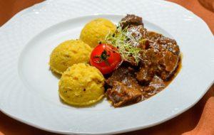 Tender beef stew with polenta